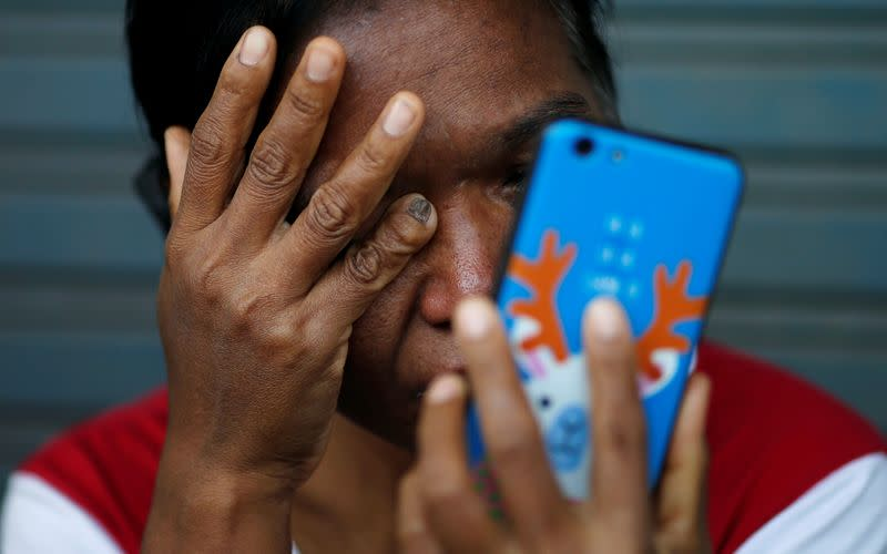 Victim's family member cries in front of the Terminal 21 shopping mall following a gun battle involving a Thai soldier on a shooting rampage, in Nakhon Ratchasima