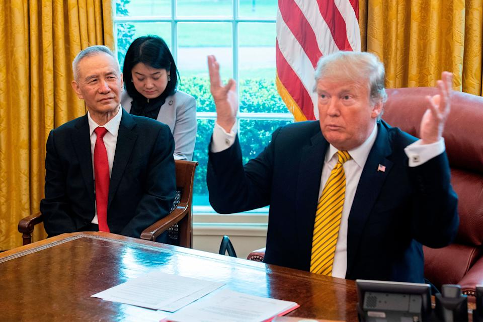 US President Donald Trump (R) speaks during a trade meeting with China's Vice Premier Liu He (L) in the Oval Office at the White House in Washington, DC, on April 4, 2019. (Photo by Jim WATSON / AFP)        (Photo credit should read JIM WATSON/AFP/Getty Images)