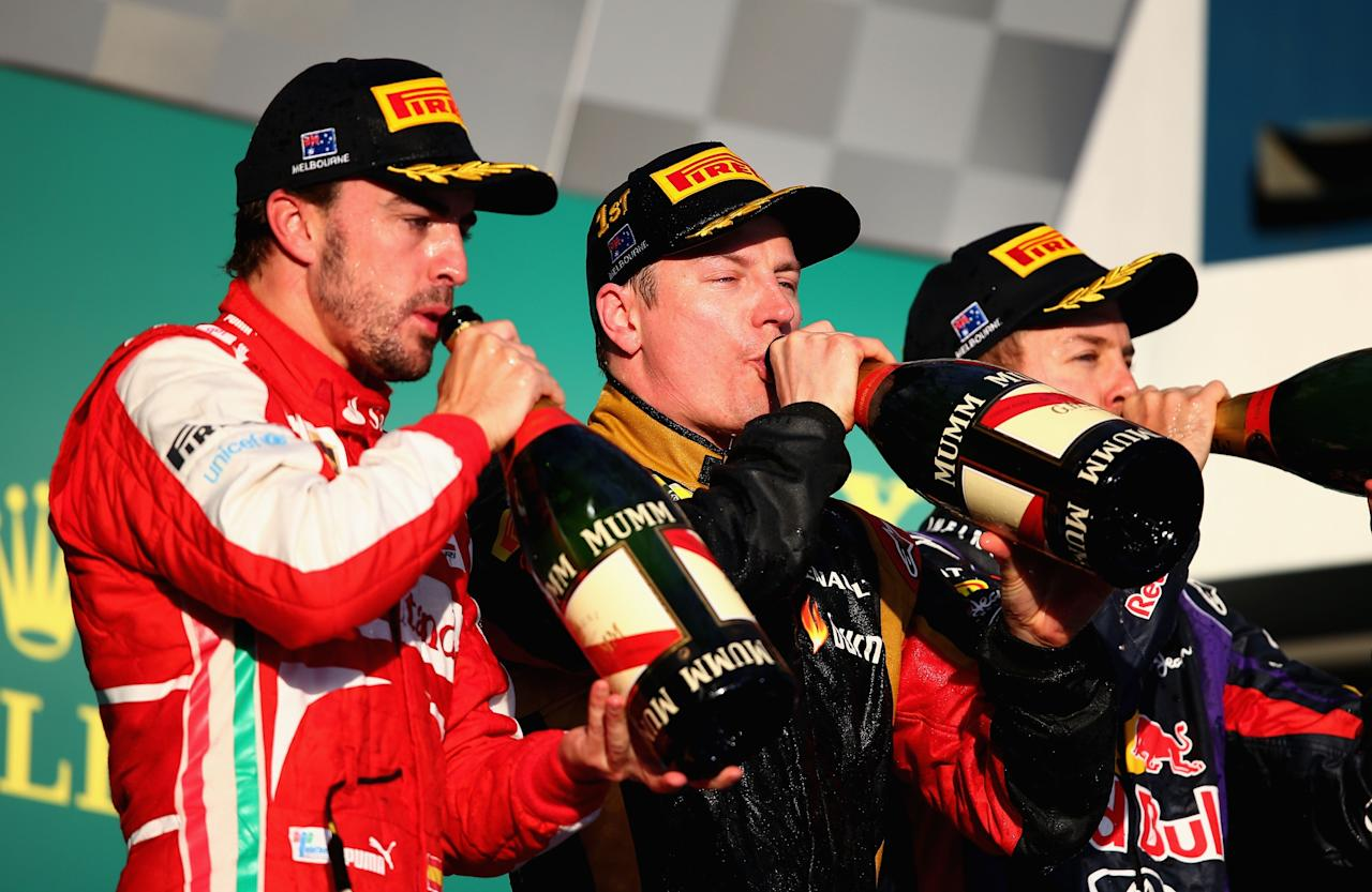 MELBOURNE, AUSTRALIA - MARCH 17:  Race winner Kimi Raikkonen (C) of Finland and Lotus celebrates on the podium with second placed Fernando Alonso (L) of Spain and Ferrari and third placed Sebastian Vettel (R) of Germany and Infiniti Red Bull Racing following the Australian Formula One Grand Prix at the Albert Park Circuit on March 17, 2013 in Melbourne, Australia.  (Photo by Clive Mason/Getty Images)
