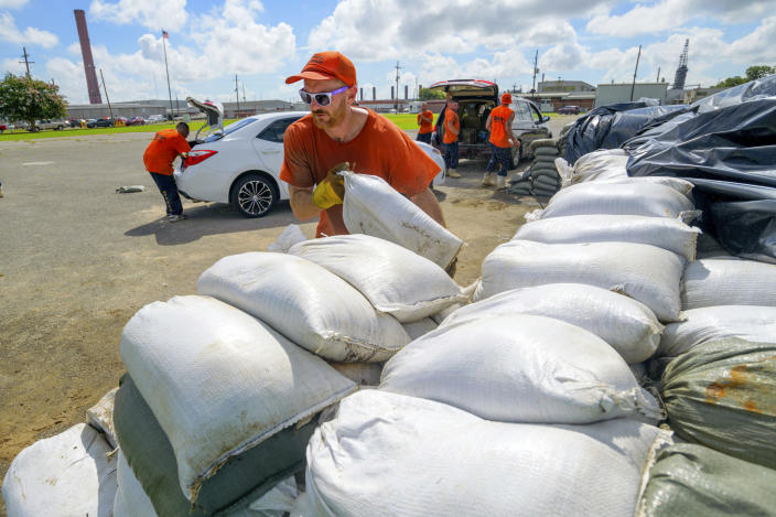 St. Bernard Parish Sheriff's Office inmate workers move free sandbags for residents in Chalmette, La., July 11, 2019. The Mississippi Emergency Management Agency is telling people in the southern part of the state to be prepared for heavy rain from Tropical Storm Barry as it pushes northward through the Gulf of Mexico. (Photo: Matthew Hinton/AP)