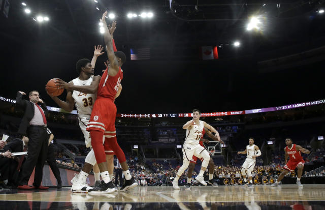 Loyola of Chicago's Franklin Agunanne (33) looks to pass as Bradley's Elijah Childs (10) defends during the first half of an NCAA college basketball game in the semifinal round of the Missouri Valley Conference tournament, Saturday, March 9, 2019, in St. Louis. (AP Photo/Jeff Roberson)