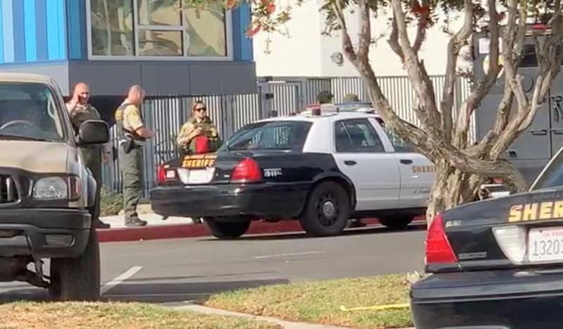 Sheriffs stand outside Saugus High School after a shooting, in Santa Clarita, California