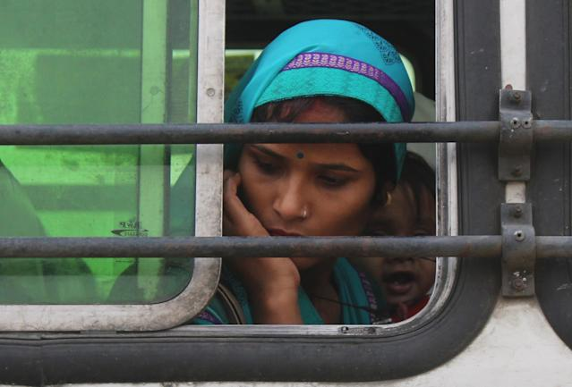 GURUGRAM, INDIA - MAY 13: Migrants at Govt Girls College Sector 14 heading by bus to board a Shramik Special train to Madhya Pradesh, on May 13, 2020 in Gurugram, India. (Photo by Yogendra Kumar/Hindustan Times via Getty Images)
