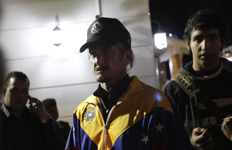 U.S. actor Sean Penn, center, who is in Bolivia to attend the hearing of Jacob Ostreicher, participates in a vigil for Venezuela's President Hugo Chavez in La Paz, Bolivia, Monday Dec. 10, 2012. Chavez's cancer relapse and his sudden announcement that he will undergo a fourth cancer-related surgery in Cuba have thrown Venezuela's future into question. Ostreicher is being held in a Bolivian prison in the eastern provincial capital of Santa Cruz while authorities investigate him for money laundering. (AP Photo/Juan Karita)
