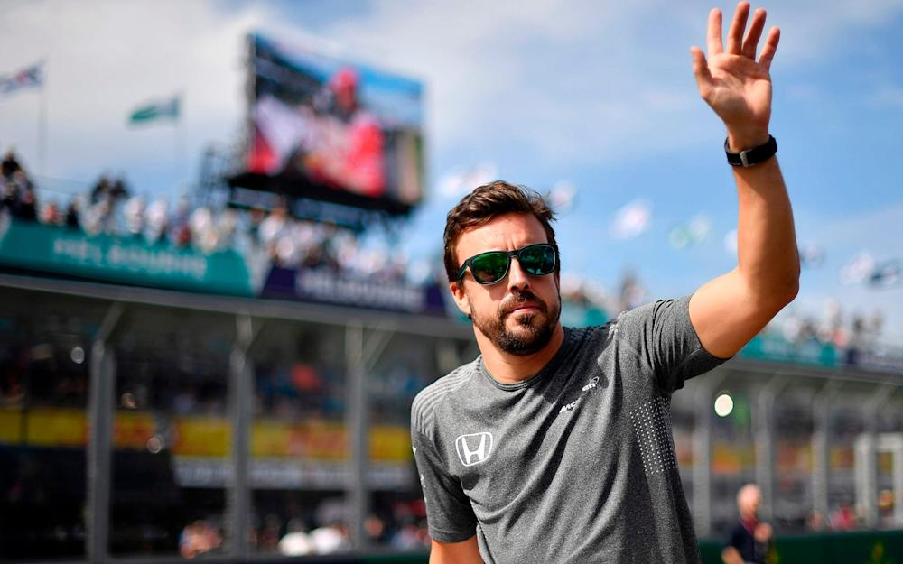 McLaren's Spanish driver Fernando Alonso takes part in the drivers parade prior to the start of the Formula One Australian Grand Prix in Melbourne on March 26, 2017. - Credit: SAEED KHAN/AFP