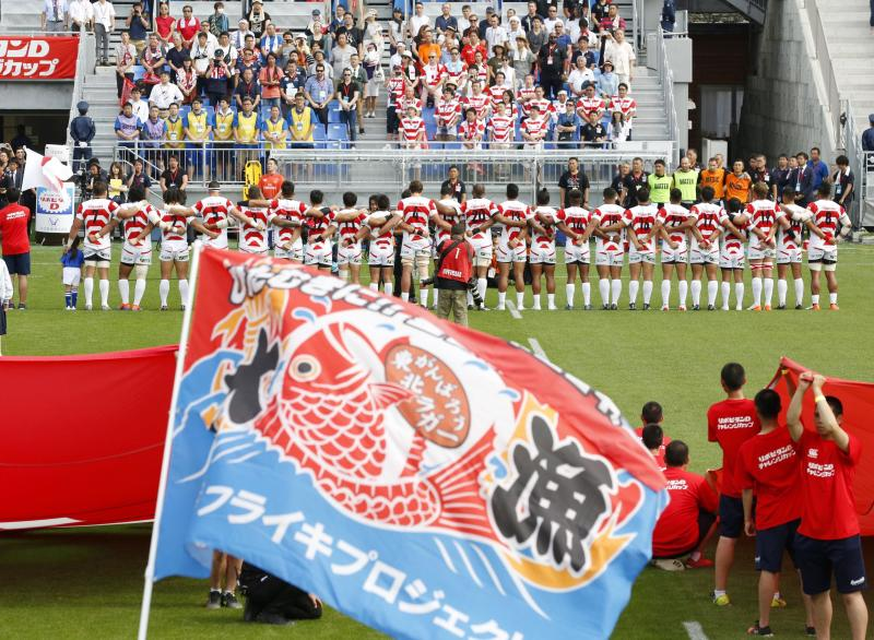 Japan's players sings national anthem before their Pacific Nations Cup rugby match against Fiji at Kamaishi Recovery Memorial Stadium in Kamaishi, northern Japan, Saturday, July 27, 2019. Japan took big step forward in Rugby World Cup preparation with a five-try 34-21 win over Fiji in Pacific Nations Cup (Yusuke Ogata/Kyodo News via AP)