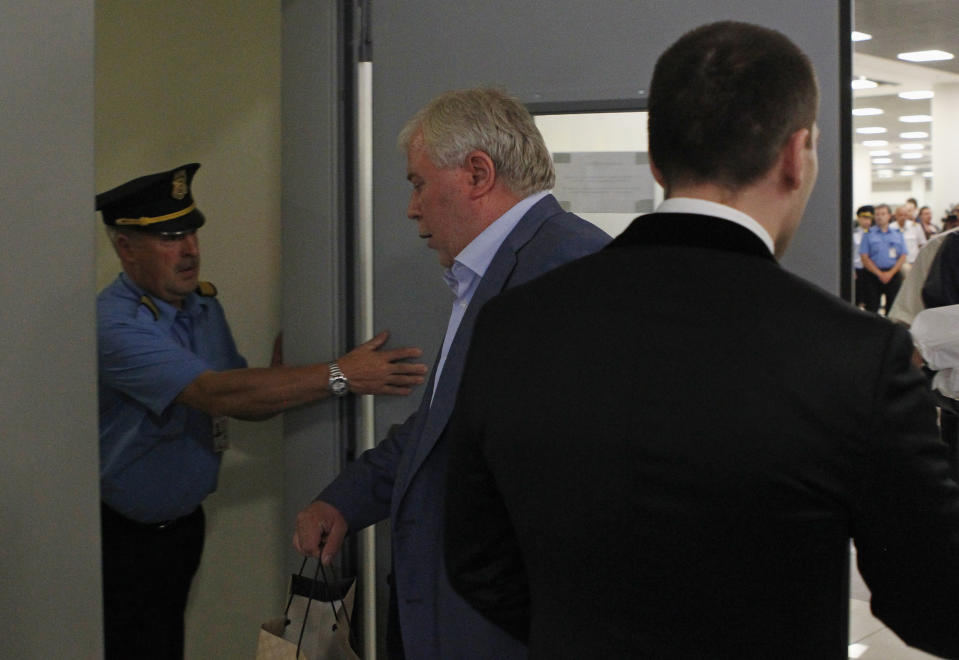 Anatoly Kucherena, center, the Russian lawyer assisting Edward Snowden, enters a restricted area at Sheremetyevo airport in Moscow. (Photo: Maxim Shemetov/Reuters)
