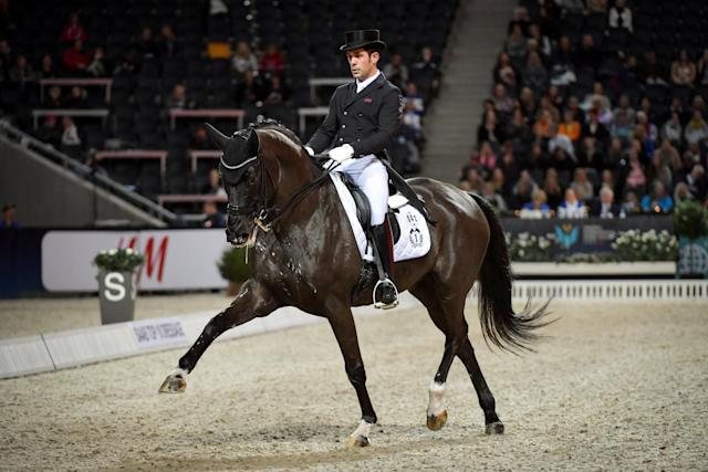 Equestrian - Sweden International Horse Show - Fei Grand Prix Dressage Qualification Event - Friends Arena, Stockholm, Sweden - December 2, 2017. Severo Jurado Lopez of Spain rides his horse Deep Impact 3. TT News Agency/Jessica Gow via REUTERS ATTENTION EDITORS - THIS IMAGE WAS PROVIDED BY A THIRD PARTY. SWEDEN OUT. NO COMMERCIAL OR EDITORIAL SALES IN SWEDEN