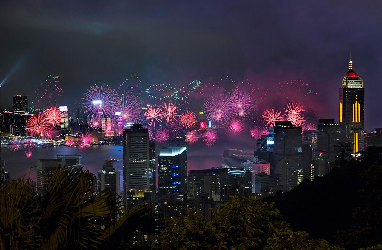 <p>Fireworks explode over the Hong Kong's Victoria Harbor, Saturday, July 1, 2017 to mark the the 20th anniversary of handover to China. (Photo: Kin Cheung/AP) </p>