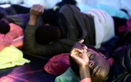 Migrants rest on the deck of  MV Aquarius, a search and rescue ship run in partnership between SOS Mediterranee and Medecins Sans Frontieres on their way to Spain, June 13, 2018. Karpov / SOS Mediterranee/handout via REUTERS