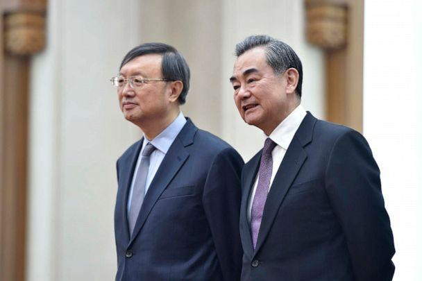 PHOTO: China's Foreign Minister Wang Yi, right, talks with China's State Councillor Yang Jiechi before a signing ceremony between Zimbabwe and China at the Great Hall of the People in Beijing, April 3, 2018. (Parker Song/AFP via Getty Images)