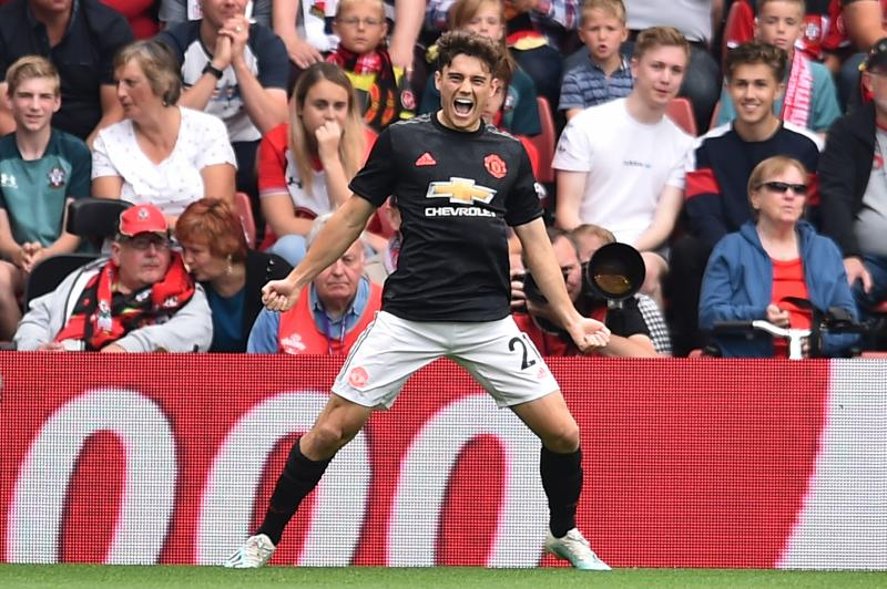 Manchester United's Welsh midfielder Daniel James celebrates scoring the opening goal during the English Premier League football match between Southampton and Manchester United at St Mary's Stadium in Southampton, southern England on August 31, 2019. (Photo by Glyn KIRK / AFP) / RESTRICTED TO EDITORIAL USE. No use with unauthorized audio, video, data, fixture lists, club/league logos or 'live' services. Online in-match use limited to 120 images. An additional 40 images may be used in extra time. No video emulation. Social media in-match use limited to 120 images. An additional 40 images may be used in extra time. No use in betting publications, games or single club/league/player publications. / (Photo credit should read GLYN KIRK/AFP/Getty Images)