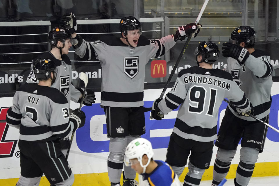 Los Angeles Kings right wing Matt Luff, center, celebrates his goal with teammates during the second period of an NHL hockey game against the St. Louis Blues, Saturday, March 6, 2021, in Los Angeles. (AP Photo/Marcio Jose Sanchez)