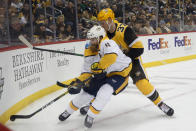 Nashville Predators' Ryan Ellis (4) goes into the corner for the puck as Pittsburgh Penguins' Sam Lafferty (37) pursues during the second period of an NHL hockey game Saturday, Dec. 28, 2019, in Pittsburgh. (AP Photo/Keith Srakocic)