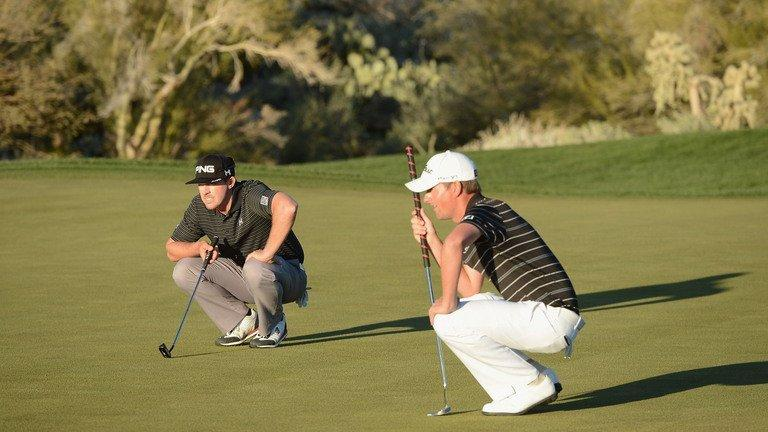 Hunter Mahan (L) and Webb Simpson line up their putts on the 18 hole during the quarter-final of the WGC Match Play Championship on February 23, 2013. Mahan, trying to join Tiger Woods as the only players to win back-to-back titles in this event, defeated US Open champion Simpson 1-up