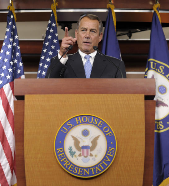 House Speaker John Boehner of Ohio calls on a reporter during a news conference on Capitol Hill in Washington, Friday, Nov. 9, 2012. Boehner said any deal to avert the so-called fiscal cliff should include lower tax rates, eliminating special interest loopholes and revising the tax code. (AP Photo/Susan Walsh)