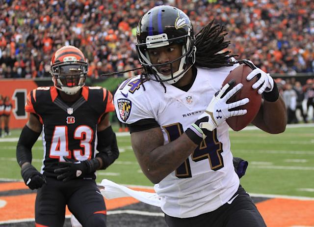 Baltimore Ravens wide receiver Marlon Brown (14) catches an 8-yard touchdown pass against Cincinnati Bengals strong safety George Iloka (43) in the second half of an NFL football game on Sunday, Dec. 29, 2013, in Cincinnati. (AP Photo/Tom Uhlman)
