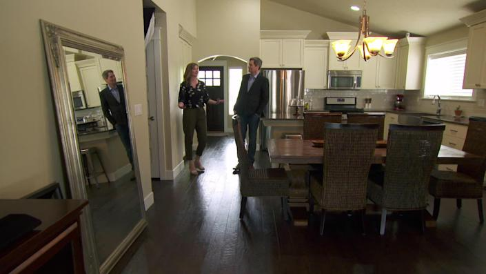 Elisha Figueroa is packing up the house she sold, which the buyer agreed to let her live in for five months, rent-free. / Credit: CBS News