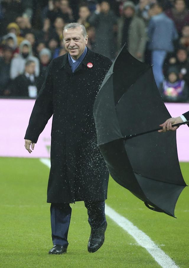 <p>Turkey's President Recep Tayyip Erdogan, walks to meet the players prior to what the organizers said was a soccer match between Turkey's soccer stars against terrorism, in Istanbul, Thursday, Dec. 22, 2016. (AP Photo) </p>