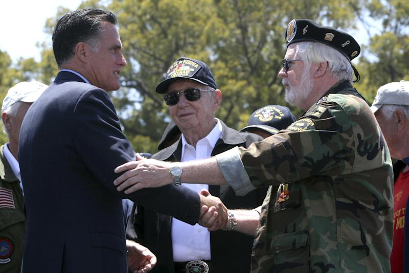 Republican presidential candidate, former Massachusetts Gov. Mitt Romney greets veterans after speaking at a campaign stop at the Veterans Museum & Memorial Center, Monday, May 28, 2012 in San Diego. (AP Photo/Mary Altaffer)