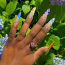 """This printed French manicure has several beautiful hues. Atlanta-based nail artist <a href=""""https://www.instagram.com/amyngn23/"""" rel=""""nofollow noopener"""" target=""""_blank"""" data-ylk=""""slk:Amy Nguyen"""" class=""""link rapid-noclick-resp"""">Amy Nguyen</a> chose a stunning color palette for Seals's nails. The contrast between the splotches and the French manicure tips looks <em>so good</em>."""