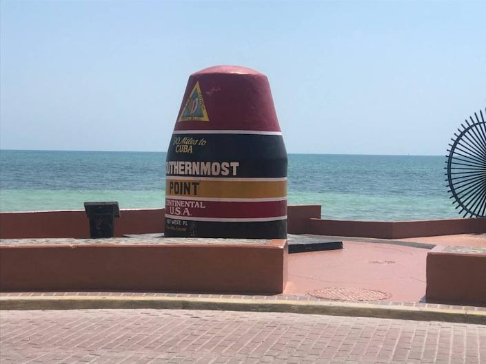 Key West's Southernmost Point buoy stood free of barricades and with a fresh coat of paint on the sidewalk on Wednesday, March 25, 2020.