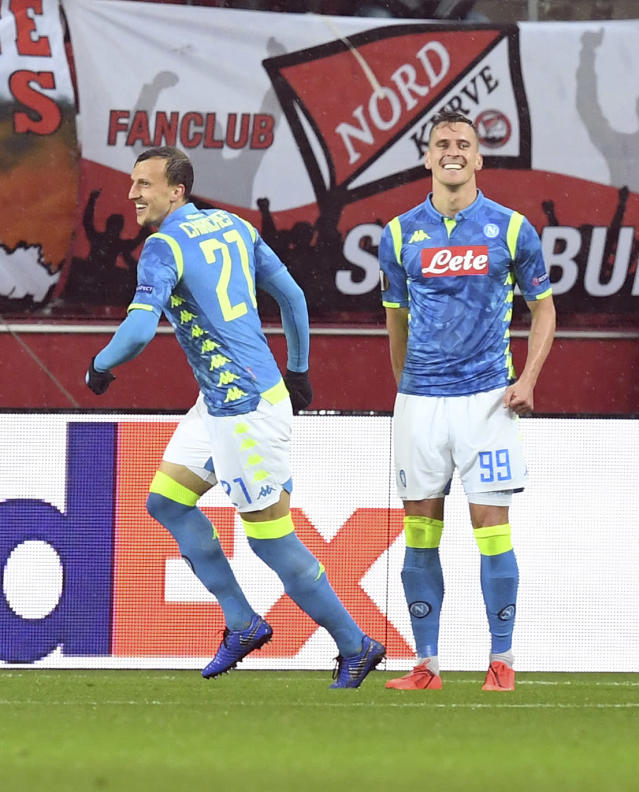 Napoli's Arkadiusz Milik, ight, celebrates with Napoli's Vlad Chiricheş after scoring his side's first goal during the Europa League round of 16 second leg soccer match between FC Salzburg and Napoli in the Arena stadium in Salzburg, Austria, Thursday, March 14, 2019. (AP Photo/Kerstin Joensson)
