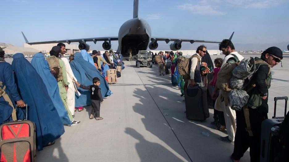 Passengers wait to evacuate Afghanistan aboard a U.S. Air Force C-17 Globemaster III at Kabul's Hamid Karzai International Airport in August. (Getty Images/U.S. Air Force photo by Master Sgt. Donald R. Allen)