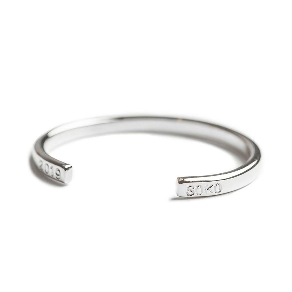 """<h3><a href=""""https://shopsoko.com/products/iga-cuff-bracelet"""" rel=""""nofollow noopener"""" target=""""_blank"""" data-ylk=""""slk:SOKO Iga Cuff Bracelet"""" class=""""link rapid-noclick-resp"""">SOKO Iga Cuff Bracelet</a></h3><br>Upgrade her arm party with a customizable cuff that can have up to four hand-stamped letters or numbers per side. <br><br><strong>Iga</strong> Iga Cuff Bracelet, $, available at <a href=""""https://go.skimresources.com/?id=30283X879131&url=https%3A%2F%2Fshopsoko.com%2Fproducts%2Figa-cuff-bracelet"""" rel=""""nofollow noopener"""" target=""""_blank"""" data-ylk=""""slk:Soko"""" class=""""link rapid-noclick-resp"""">Soko</a>"""
