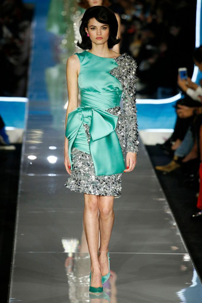 <p>A turquoise-and-silver sequin bow dress at the Moschino FW18 show. (Photo: Getty) </p>