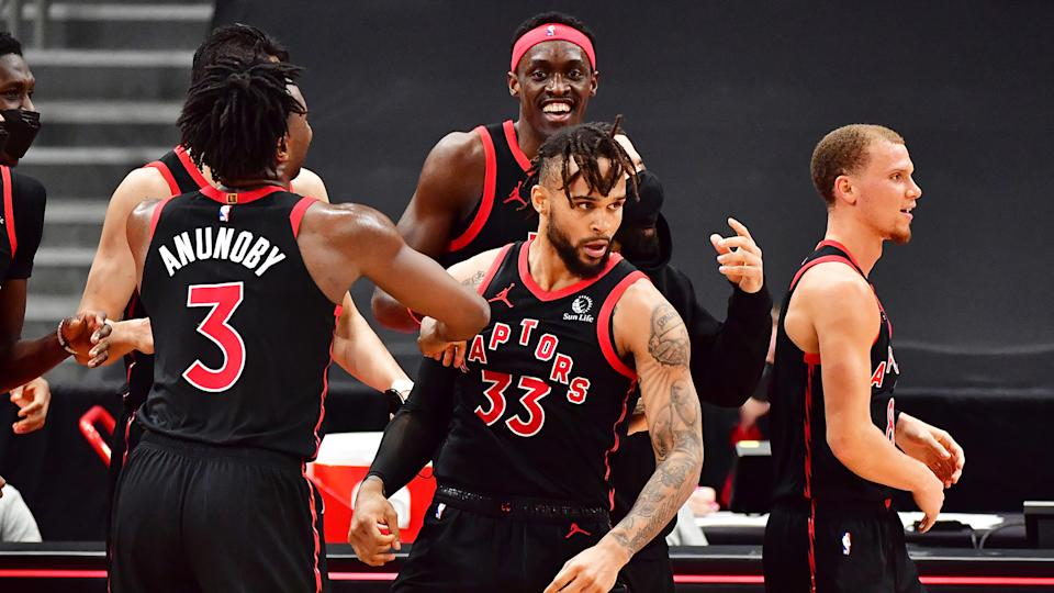 Gary Trent Jr. #33 of the Toronto Raptors celebrates with teammates after hitting a game-winning shot. (Photo by Julio Aguilar/Getty Images)