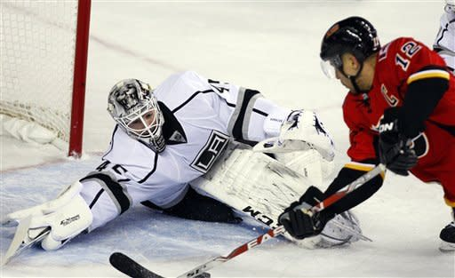 Los Angeles Kings goalie Jonathan Bernier, left, stops a shot by Calgary Flames' Jarome Iginla during the first period of their NHL hockey game, Wednesday, Feb. 20, 2013, in Calgary, Alberta. (AP Photo/The Canadian Press, Jeff McIntosh)