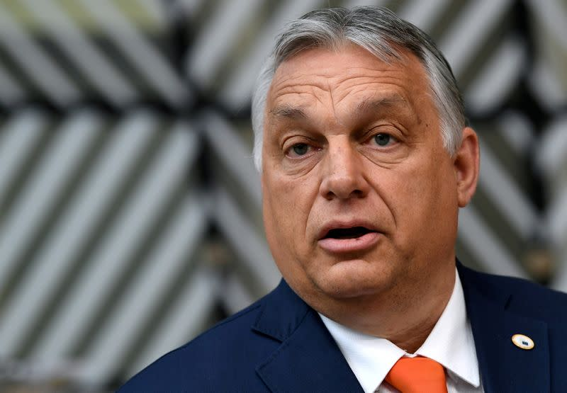 FILE PHOTO: Hungary's Prime Minister Viktor Orban addresses the media as he arrives on the first day of the European Union summit at The European Council Building in Brussels, Belgium June 24, 2021.