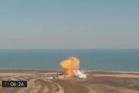 The SpaceX Starship SN9 prototype rocket explodes after descending from a test flight in Boca Chica
