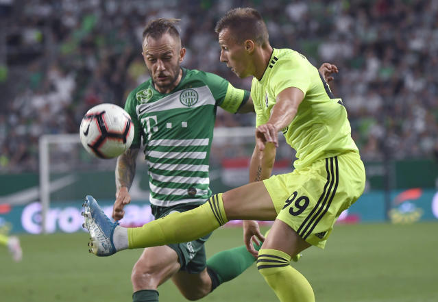 Ferencvaros' Gergely Lovrencsics, left, vies for the ball with Dinamo Zagrb's Mislav Orsic during the Champions League third qualifying round first leg soccer match between Ferencvaros and Dinamo Zagreb in Budapest, Hungary, Tuesday, Aug. 13, 2019. (Tibor Illyes/MTI via AP)