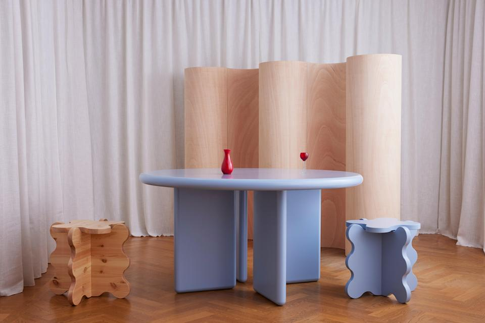 An assortment of Gustaf Westman's signature tables in light blue.