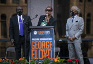 """George Floyd's sister, Bridgett Floyd, addresses a rally in downtown Minneapolis, Sunday, May 23, 2021. At left is attorney Ben Crump. At right is the Rev. Al Sharpton. """"It has been a long year. It has been a painful year,"""" Floyd's sister Bridgett told the crowd on Sunday.(Jeff Wheeler/Star Tribune via AP)"""
