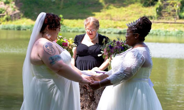 The author (left) and her wife, Jodyann Morgan, being married by L.S. Quinn. (Photo: <a href=&quot;https://www.naturalnerddesigns.com/&quot; target=&quot;_blank&quot;>Photo by Danielle Lawson, Natural Nerd Designs</a>)