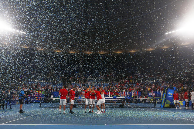 Serbia hold up the ATP CUP after defeating Spain during their ATP Cup tennis tournament in Sydney, Monday, Jan. 13, 2020. (AP Photo/Steve Christo)