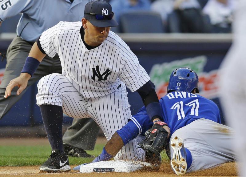 Toronto Blue Jays Rajai Davis (11) is safe stealing third as New York Yankees third baseman Alex Rodriguez applies a late tag in the fourth inning of a baseball game at Yankee Stadium, Thursday, Aug. 22, 2013, in New York. (AP Photo/Kathy Willens)
