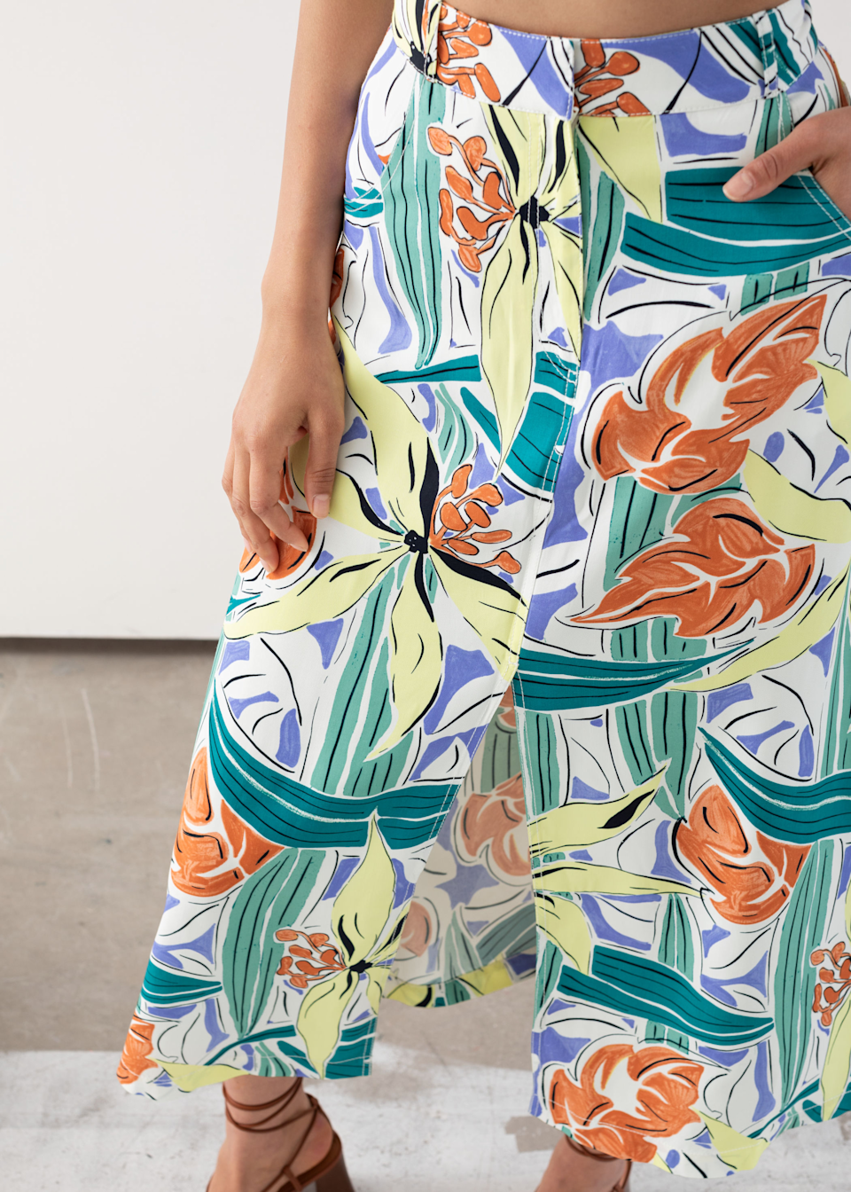 """<h2>Escapist Print</h2> <br>You're not alone in wanting a vacation. After being indoors this long, we could all use an escape. In the meantime, transport yourself to a beach by stocking up on all the tropical prints available.<br><br><strong>& Other Stories</strong> Front Slit A-Line Midi Skirt, $, available at <a href=""""https://go.skimresources.com/?id=30283X879131&url=https%3A%2F%2Fwww.stories.com%2Fen_usd%2Fclothing%2Fskirts%2Fmidi-skirts%2Fproduct.front-slit-a-line-midi-skirt-white.0747247003.html"""" rel=""""nofollow noopener"""" target=""""_blank"""" data-ylk=""""slk:& Other Stories"""" class=""""link rapid-noclick-resp"""">& Other Stories</a><br>"""