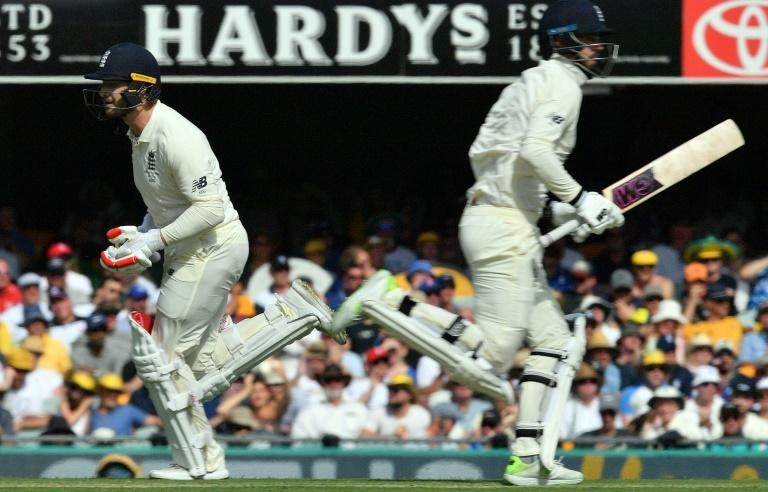 England's batsmen James Vince and Mark Stoneman run between the wickets on the first day of the first Ashes Test in Brisbane, on November 23, 2017