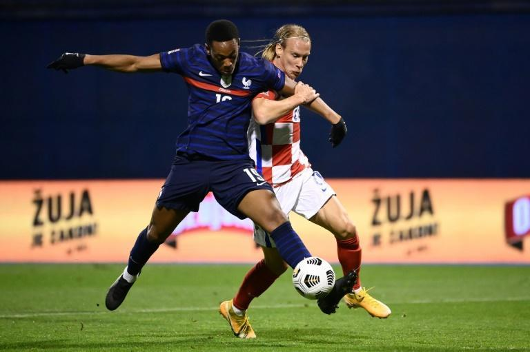 Croatia defender Domagoj Vida, shown challenging France's Anthony Martial in a Nations League match in October, played half a friendly match against Turkey without knowing he was positive for Covid-19