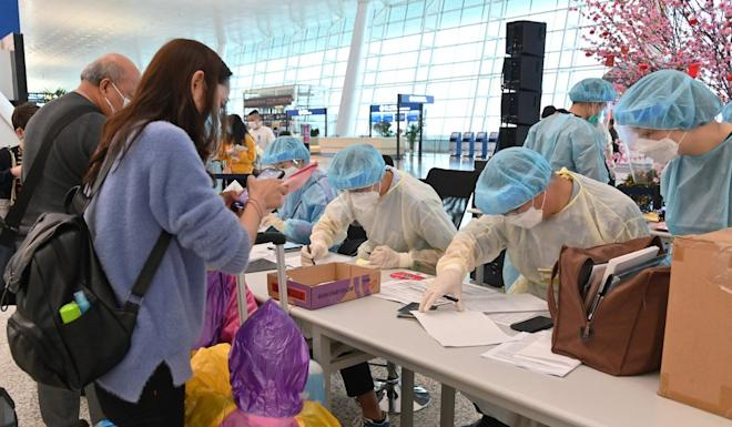 A family registers with immigration authorities at Wuhan Tianhe International Airport before finally returning to Hong Kong. Photo: Handout