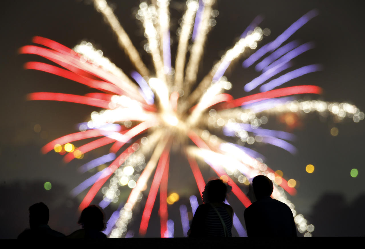 <p>People watch fireworks set off by private citizens to celebrate Independence Day, from a vantage point at the Liberty Memorial on Wednesday, July 4, 2018, in Kansas City, Mo. (Photo: Charlie Riedel/AP) </p>