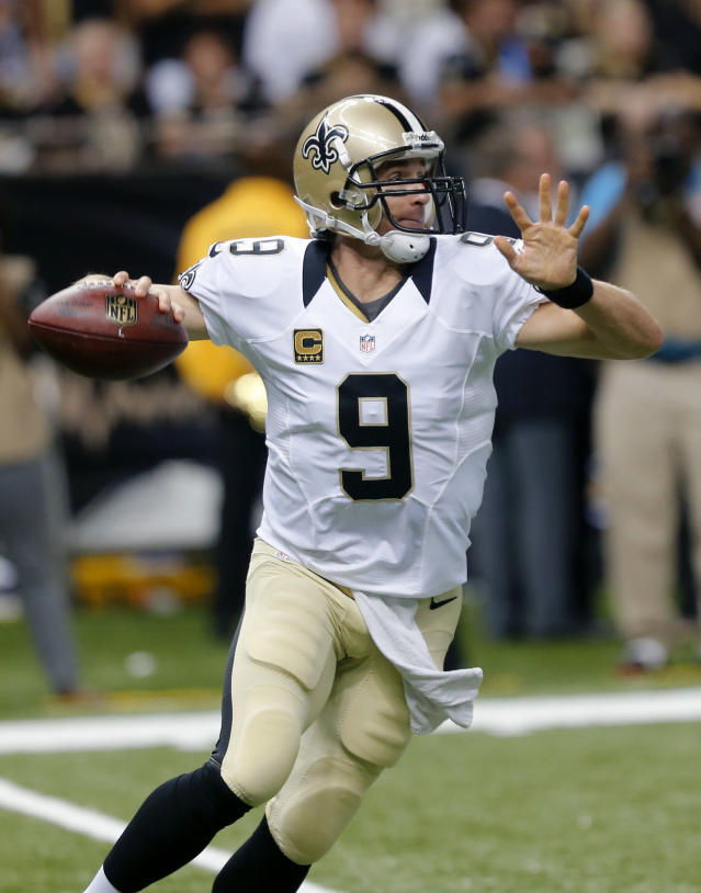 New Orleans Saints quarterback Drew Brees (9) scrambles in the first half of an NFL football game against the Atlanta Falcons in New Orleans, Sunday, Sept. 8, 2013. (AP Photo/Bill Haber)