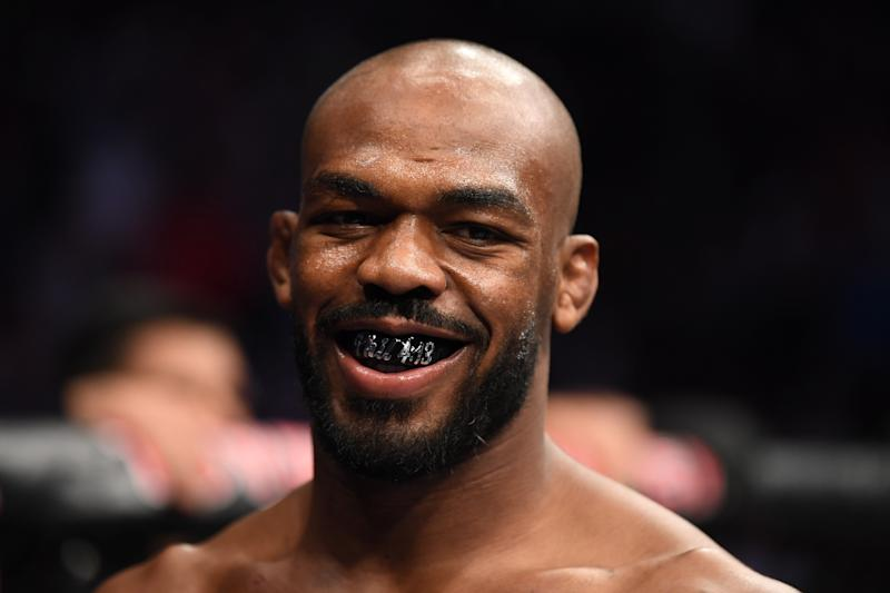 Jon Jones smiles and stands in his corner prior to UFC 247.