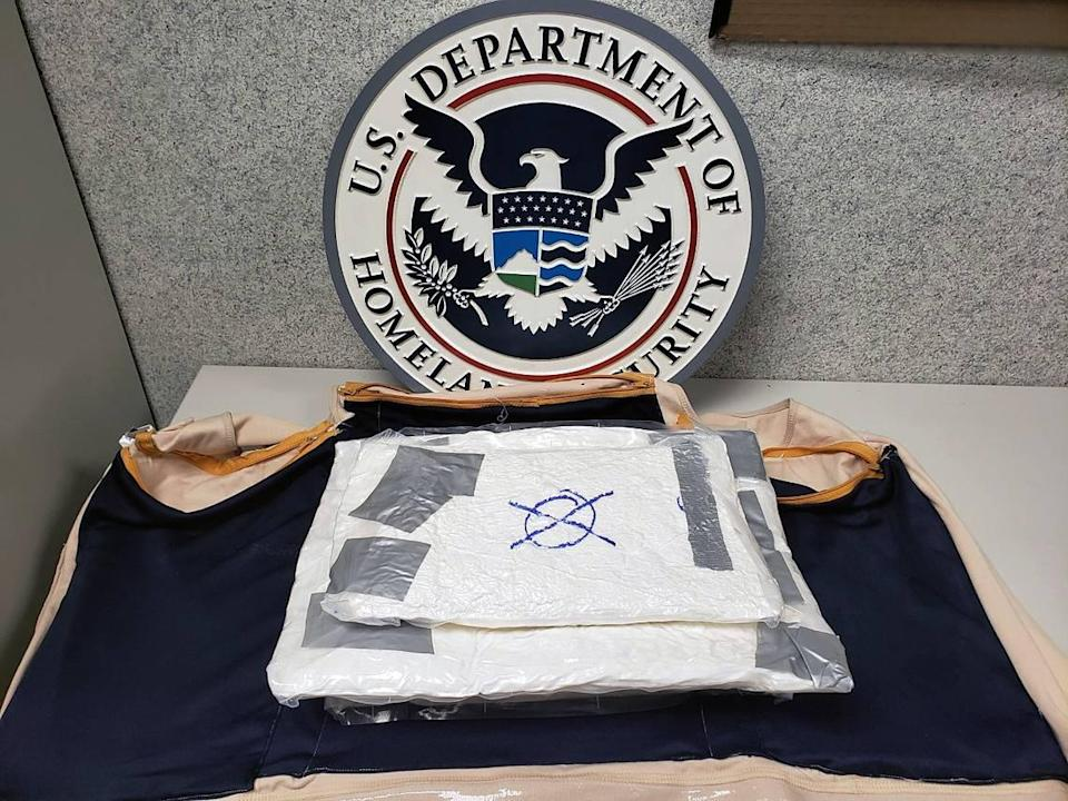 Xavier E. Ramirez, 23, is charged with felony possession and trafficking of cocaine after U.S. Customs and Border Protection said its officers noticed a bulge in his shirt that turned out to be cocaine on July 17, 2021.