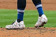 St. Louis Cardinals starting pitcher Jack Flaherty (22) wears cleats supporting the Black Lives Matter movement during the first inning of a baseball game against the Cleveland Indians, Saturday, Aug. 29, 2020, in St. Louis. (AP Photo/Scott Kane)