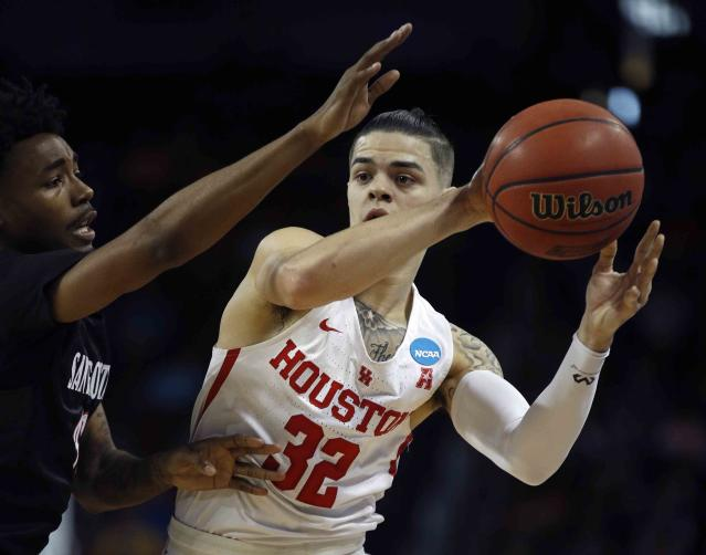 Houston guard Rob Gray, right, is pressured by San Diego State guard Jeremy Hemsley, left, during the first half of an NCAA men's college basketball tournament first-round game Thursday, March 15, 2018, in Wichita, Kan. (AP Photo/Charlie Riedel)